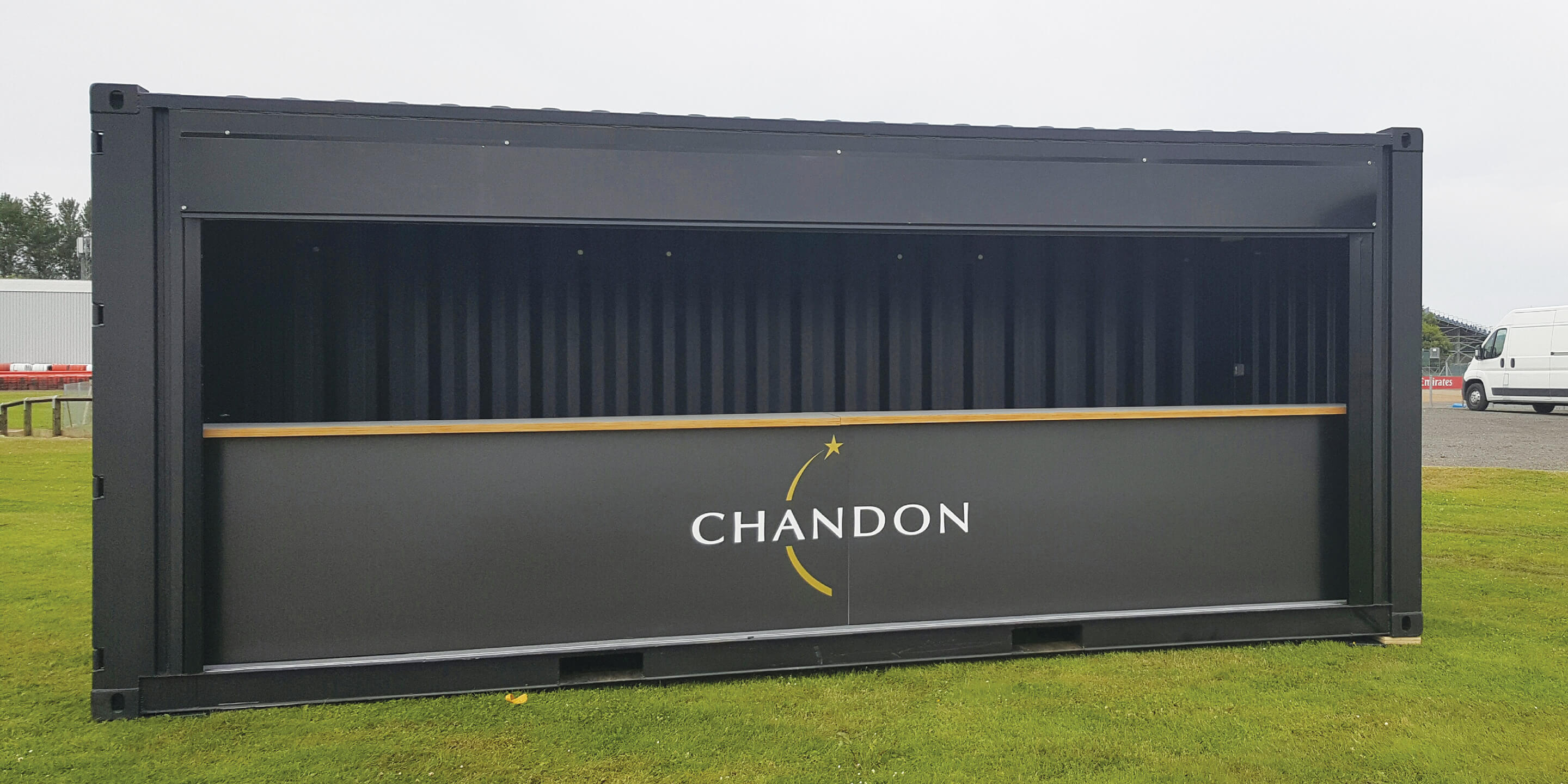 Chandon black shipping container conversion festival bar on location