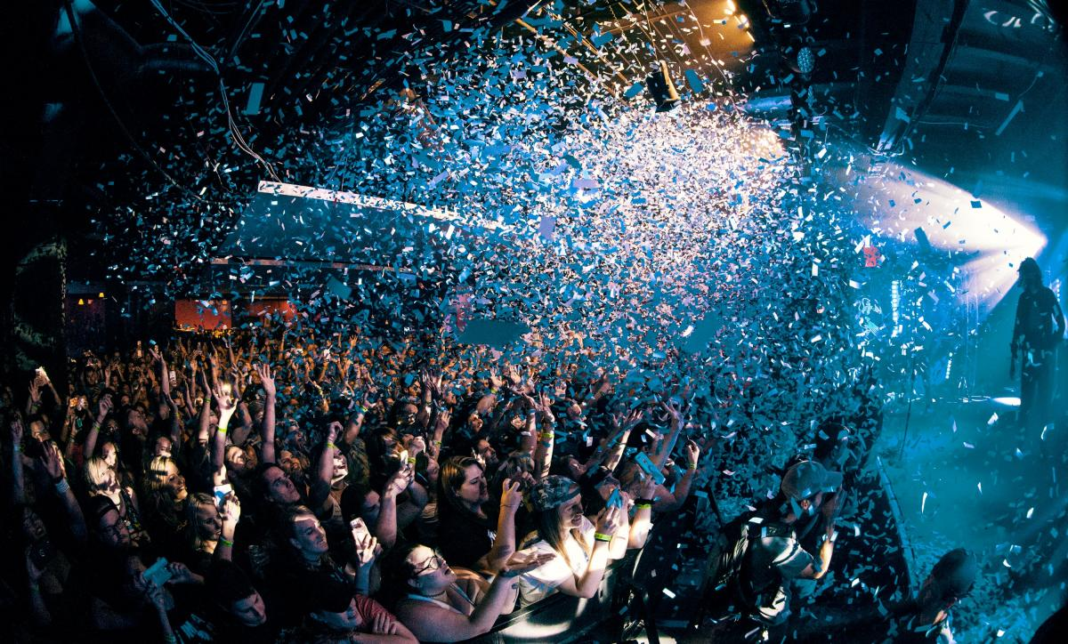 confetti launched over crowd of people at experiential event